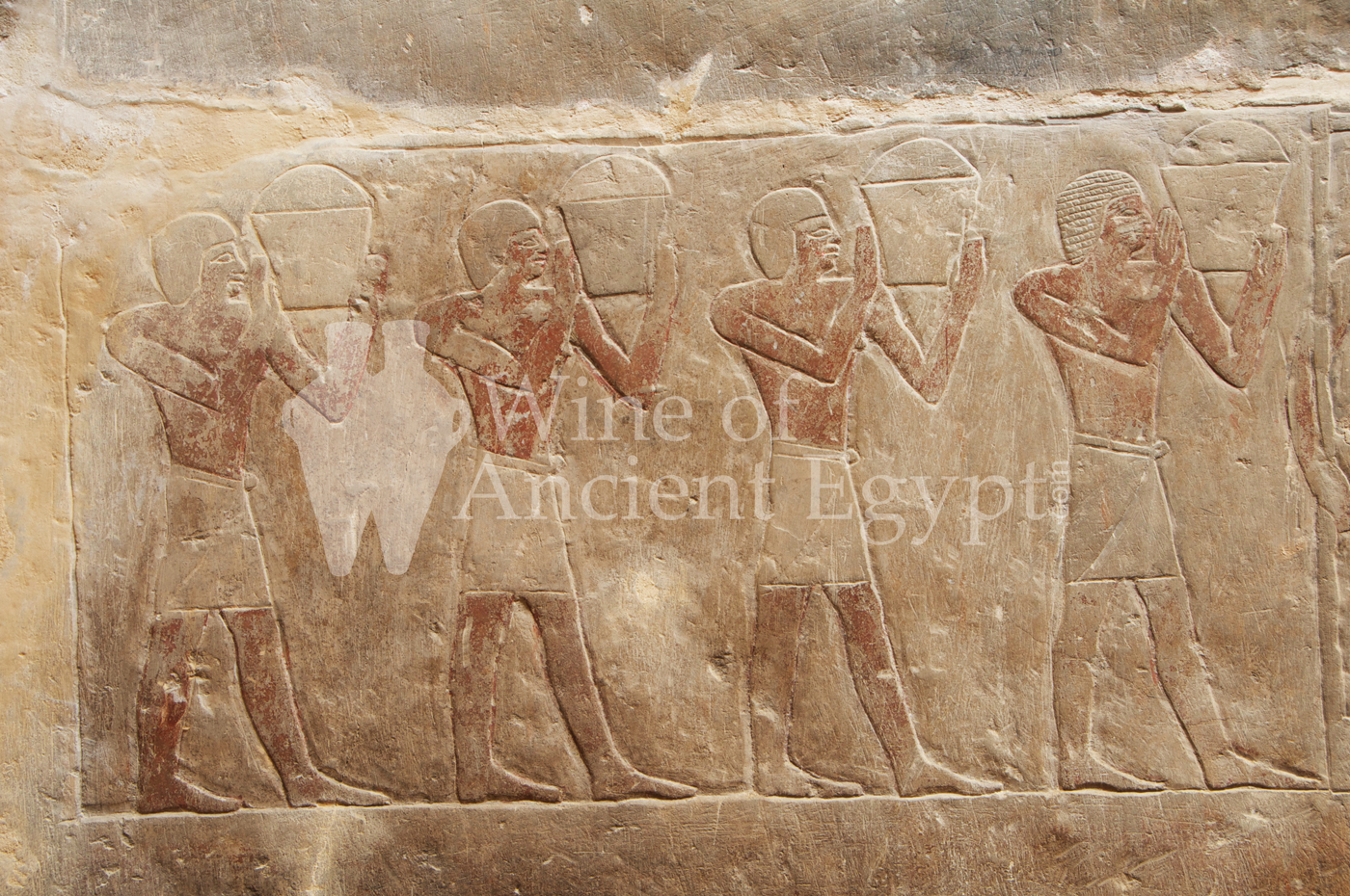Men transporting baskets of grapes to the wine press. Mereruka. Saqqara. Dynasty 6