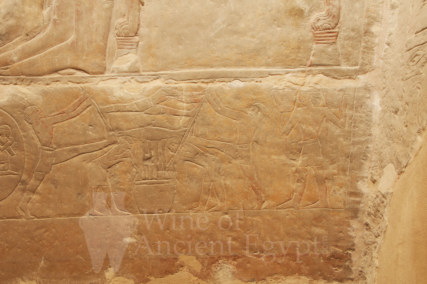 Men working a wine sack-press and a man carrying two baskets of grapes. Mereruka. Saqqara. Dynasty 6